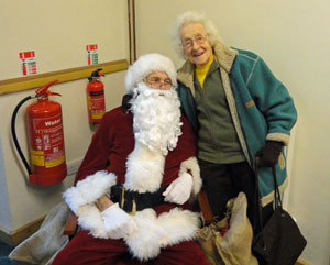 Joyce Wright with Santa at Christmas Craft Fair