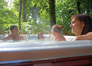 Relax in an outdoor hot tub at Keldy Forest Holiday Lodges near Pickering