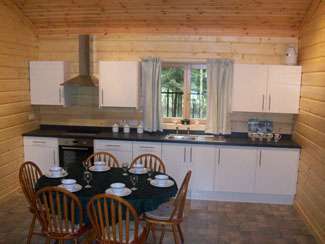 Open plan kitchen at Chloes Lodge Sycamore Farm Log Cabin - Cropton near Pickering