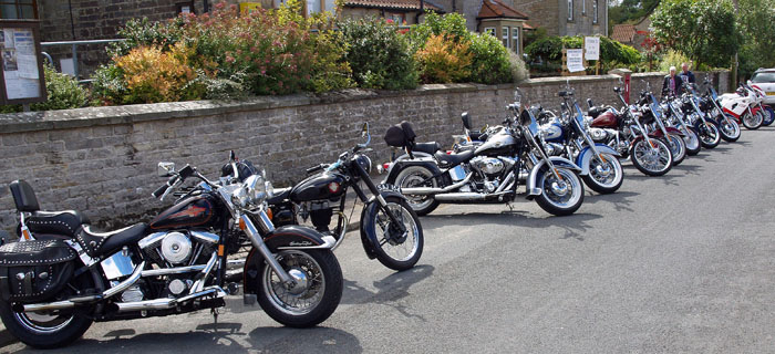Motorbikes outside Cropton Village Hall at Classic bike rally August 2014