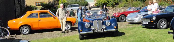 Classic vintage car arriving at Cropton village hall field 2016