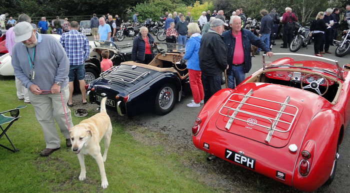 Car owner walking the dog at Cropton Vintage Car Rally 2017