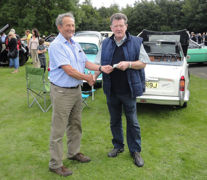 Dick Feaster (Secretary of Cropton Village Hall) presented cheque to Dave Greaves (President of Teeside Yesteryear Motor Club)