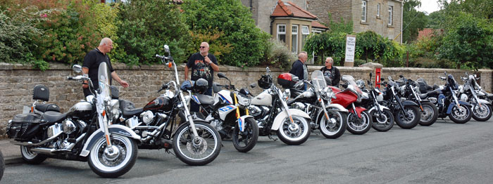 Harley Davidson motorcycles on display in Cropton main street at the 2018 vintage rally