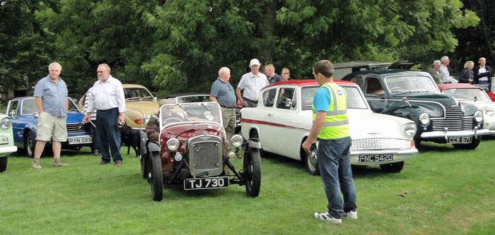 Steward lining up the vintage vehicles at Cropton rally in Cropton village hall field - Rally 2018